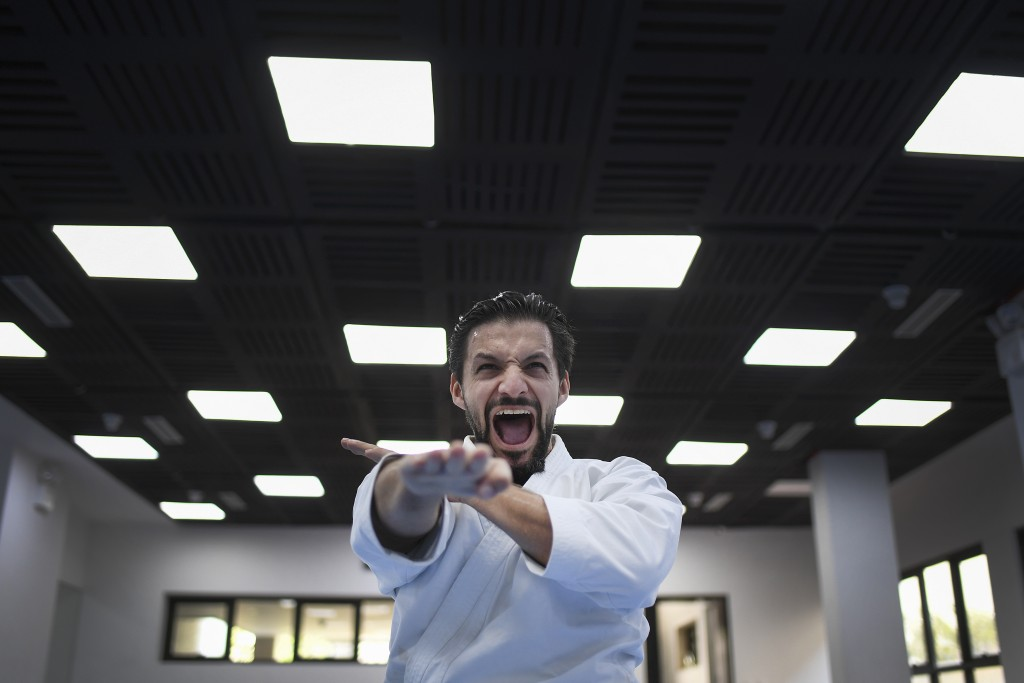 Venezuelan karateka athlete Antonio Diaz, a two-time world champion, trains alone in his studio, where he also taught before the lockdown, in Caracas,...