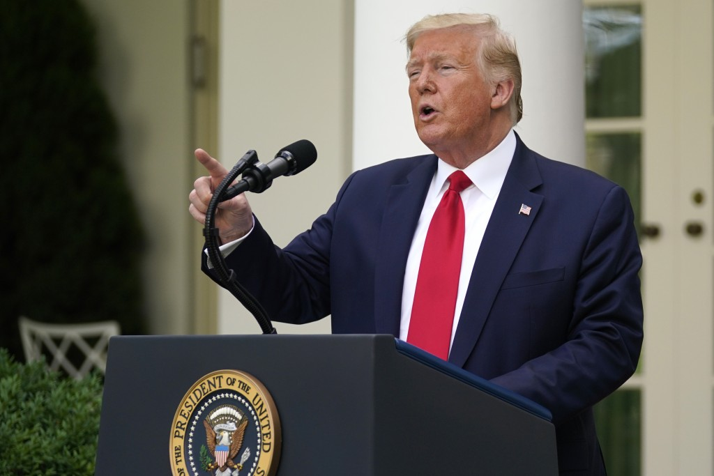 President Donald Trump answers questions from reporters during an event on protecting seniors with diabetes in the Rose Garden White House, Tuesday, M...