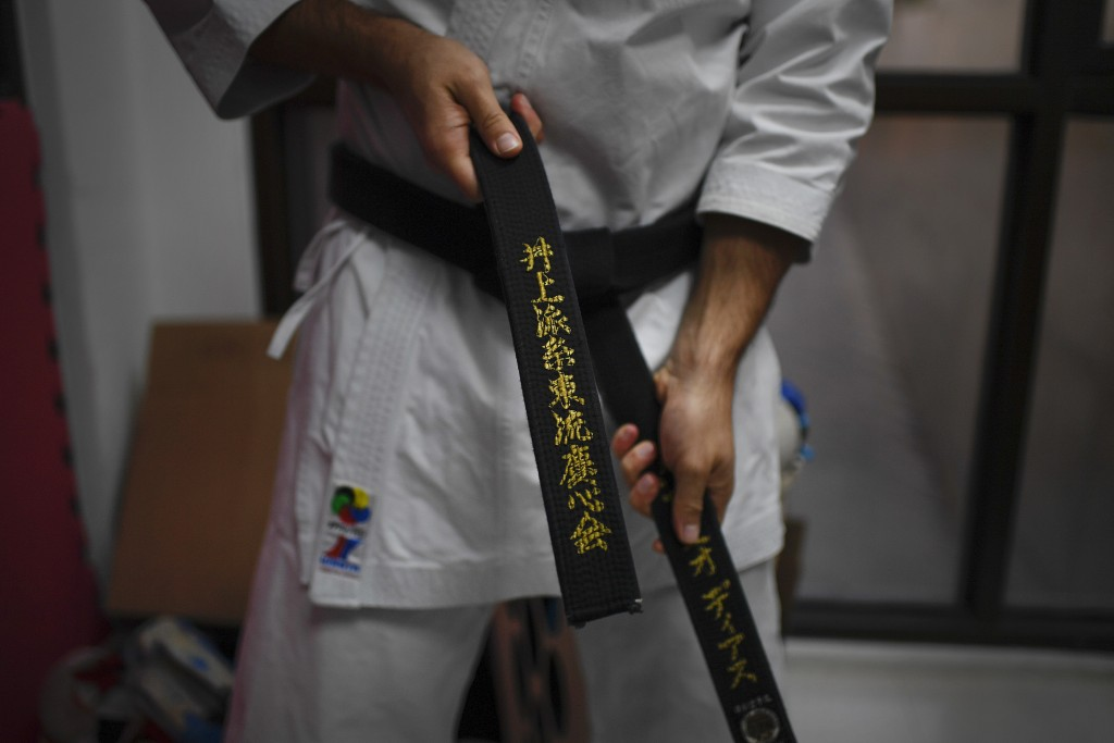 Venezuelan karateka athlete Antonio Diaz, a two-time world champion, ties his black belt before training in his dojo, where he also taught before the ...