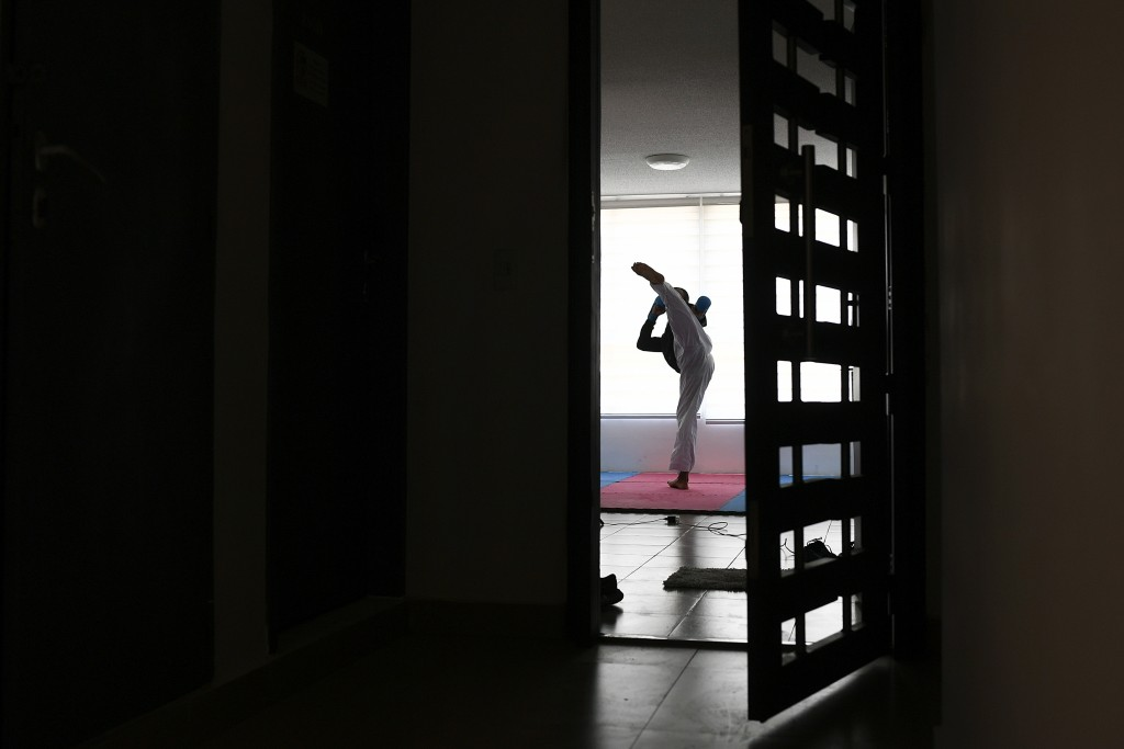 Venezuelan karateka athlete Andres Madera, a gold medalist at the Pan American Games in Peru last year, trains alone in his apartment in Caracas, Vene...