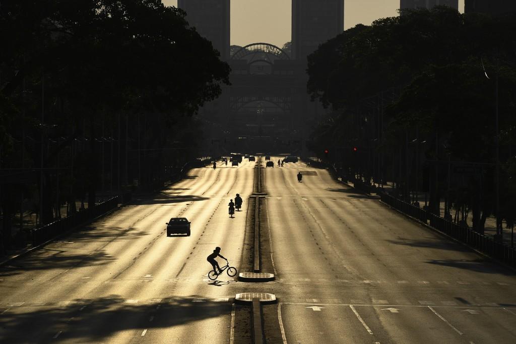Venezuelan Olympic medalist Stefany Hernandez, a BMX racing cyclist, rides across an empty Bolivar Avenue amid the new coronavirus pandemic in Caracas...