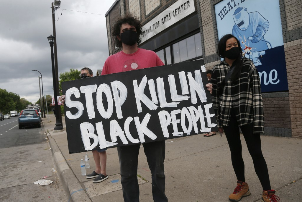 Protesters gather near the site of the death of a man, Tuesday, May 26, 2020, who died in police custody Monday night in Minneapolis after video share...