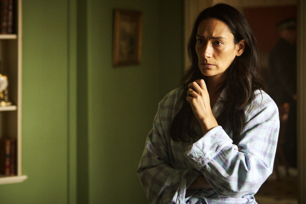 """This image released by AMC/ITV shows Sian Clifford as Diana Ingram in a scene from """"Quiz,"""" about a couple accused of cheating their way to the top pri..."""