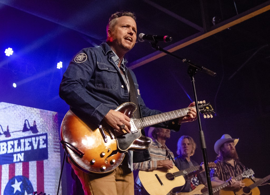 FILE - This March 9, 2020 file photo shows Jason Isbell, from left, Todd Snider, T.J. Osborne and Aaron Lee Tasjan performing at the To Nashville, Wit...