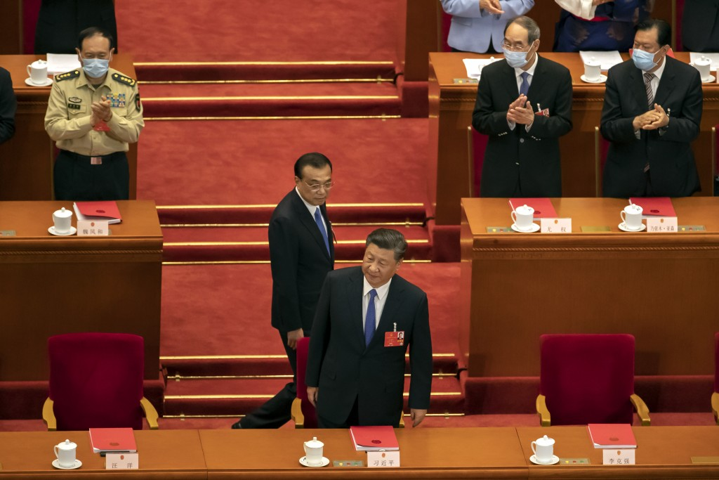 Chinese leader Xi Jinping (front), Premier Li Keqiang at National People's Congress in Beijing.