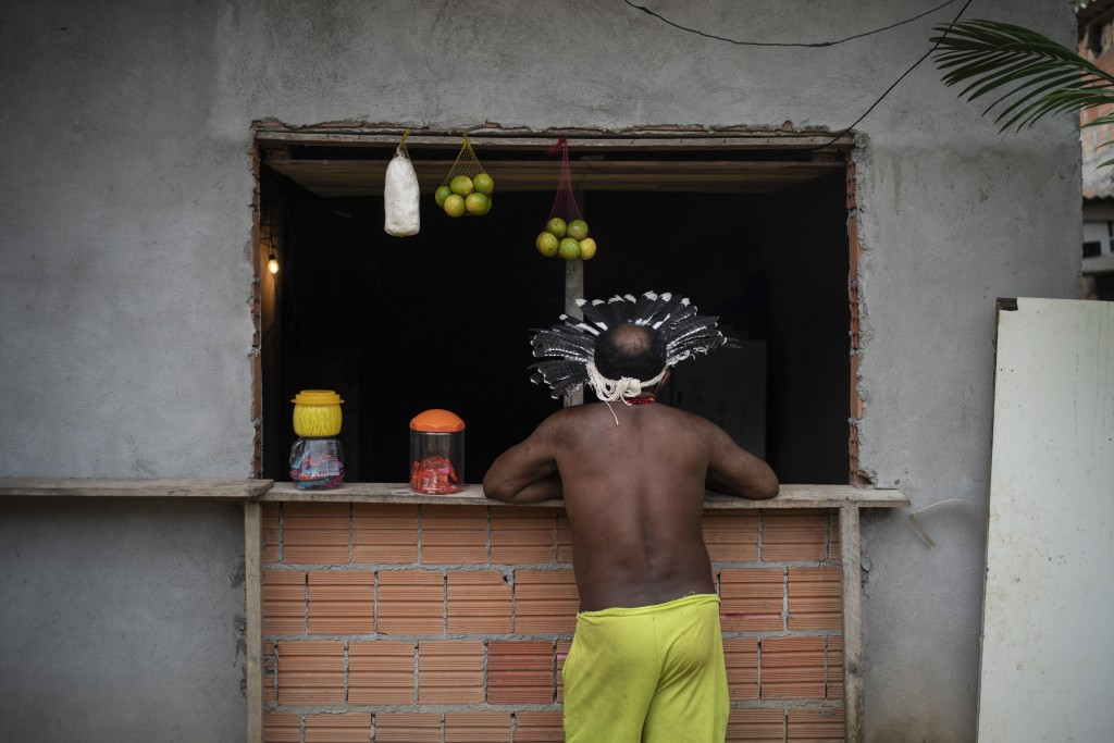 Pedro dos Santos, the leader of a community named Park of Indigenous Nations, stands outside a small market in Manaus, Brazil, Sunday, May 10, 2020. A...