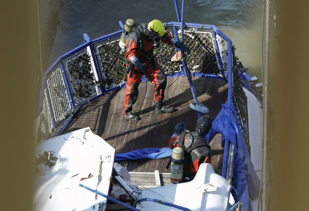 FILE- In this Tuesday, June 11, 2019, file photo a diver looks for bodies on the sunken ship in Budapest, Hungary. Preparations are underway for comme...