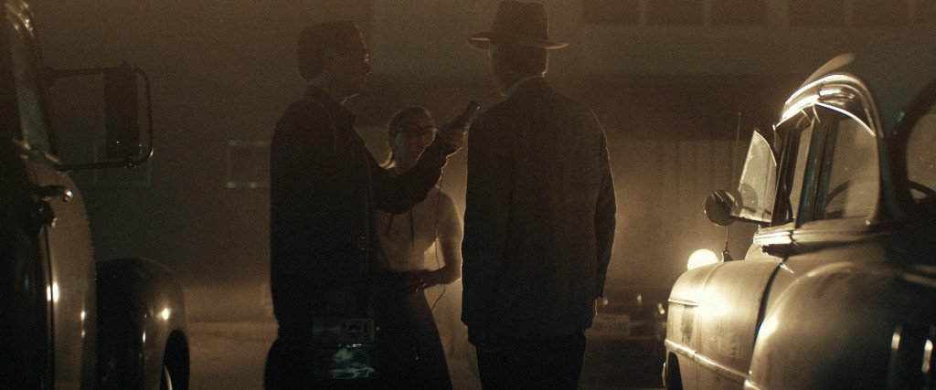 """This image released by Amazon Studios shows Jake Horowitz, left, and Sierra McCormick, center, in a scene from """"The Vast of Night."""" (Amazon Studios vi..."""