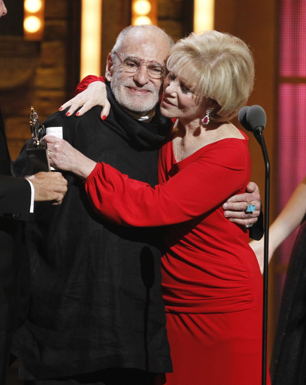"""FILE -This June 12, 2011 file photo shows Larry Kramer, left, and Daryl Roth embracing after they won the Tony Award for Best Revival of a Play for """"T..."""