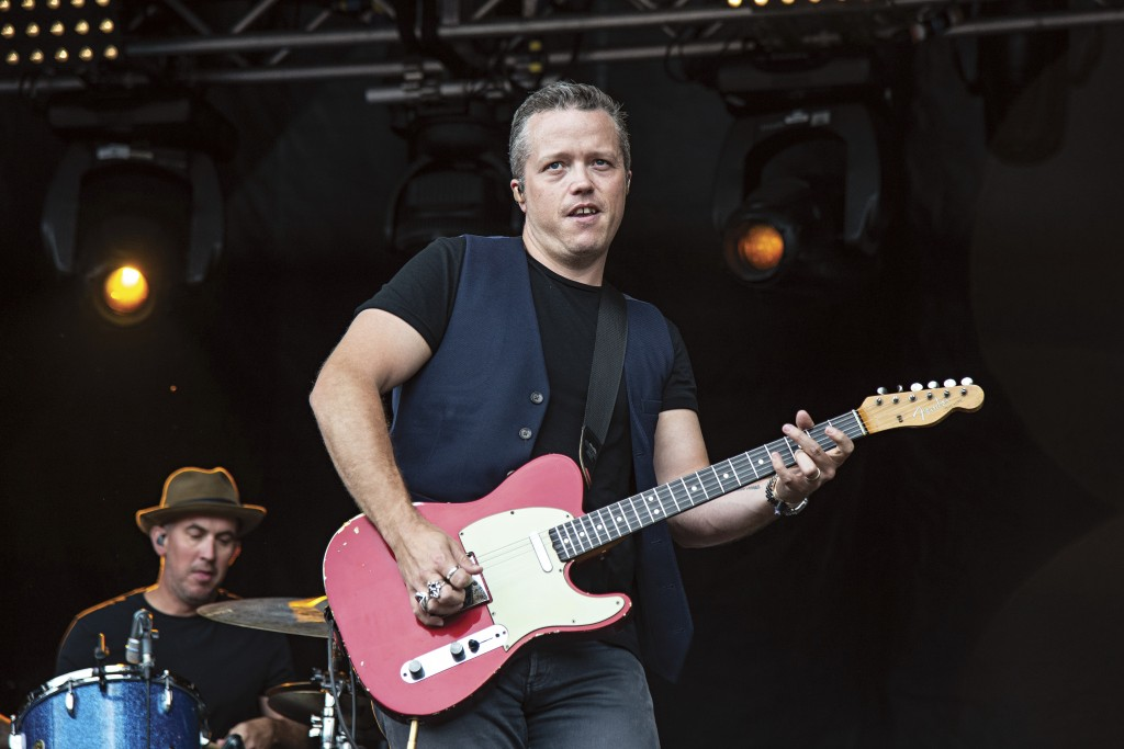 FILE - This July 15, 2018 file photo shows Jason Isbell, of Jason Isbell & The 400 Unit, performing at Forecastle Music Festival in Louisville, Ky. Is...