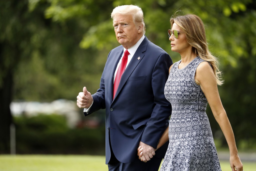 President Donald Trump and first lady Melania Trump walk on the South Lawn of the White House in Washington, Wednesday, May 27, 2020, before boarding ...
