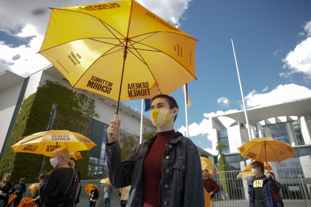 Activists of the Generation-Foundation hold symbolic rescue umbrellas in their hands during a protest in front of the chancellery in Berlin, Germany, ...