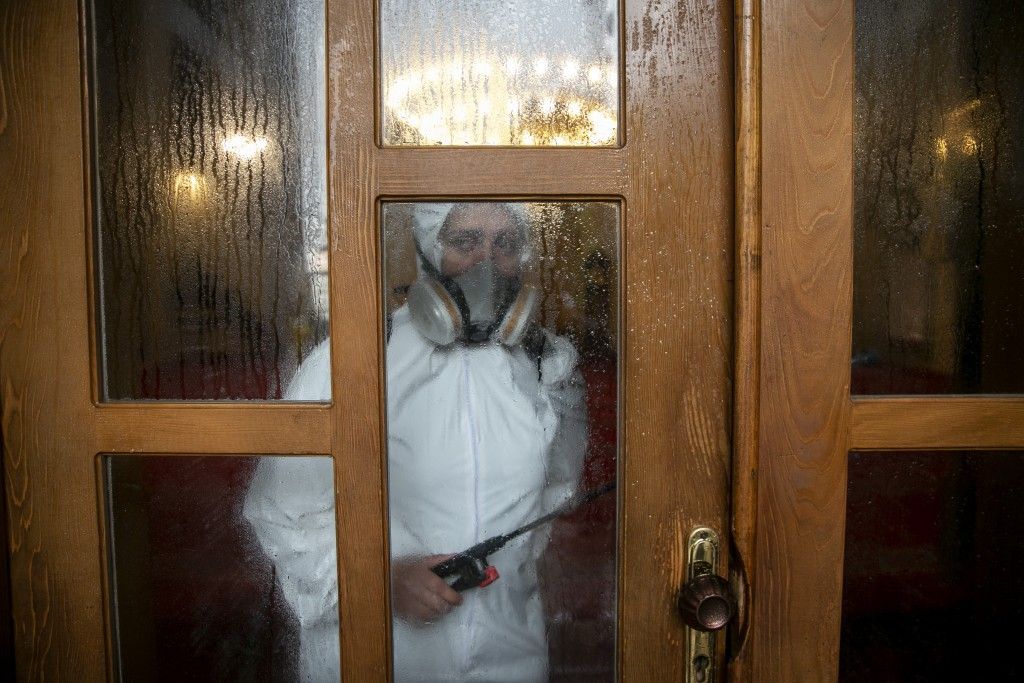 Disinfection team disinfect the premises of the grand mosque in capital Pristina, Kosovo on Thursday, May 28, 2020. Kosovo's mosques reopened on Thurs...