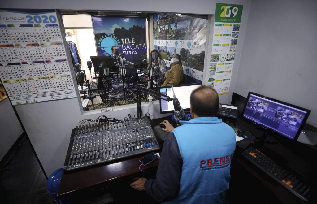 Teachers dictate class, broadcast through Bacata Stereo radio station, during the lockdown to prevent the spread of the new coronavirus in Funza, Colo...