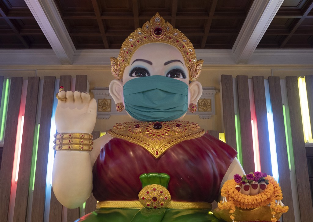 A giant statue of the Thai spiritual Nagkwank is dressed with a face mask at the Siam museum in Bangkok, Thailand, Friday, May 29, 2020. Nagkwank is a...