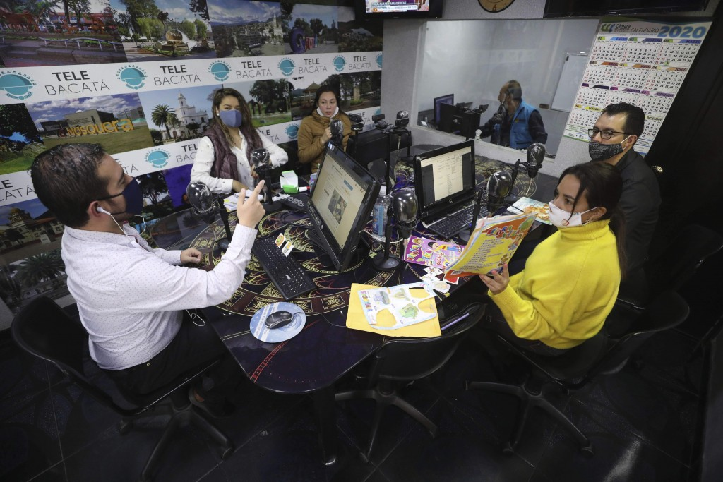 Teachers impart a lesson, broadcast through Bacata Stereo radio station, during the lockdown to prevent the spread of the new coronavirus in Funza, Co...