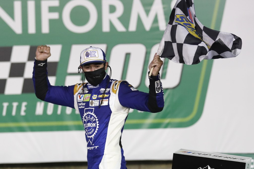 Chase Elliott celebrates after winning a NASCAR Cup Series auto race at Charlotte Motor Speedway Thursday, May 28, 2020, in Concord, N.C. (AP Photo/Ge...