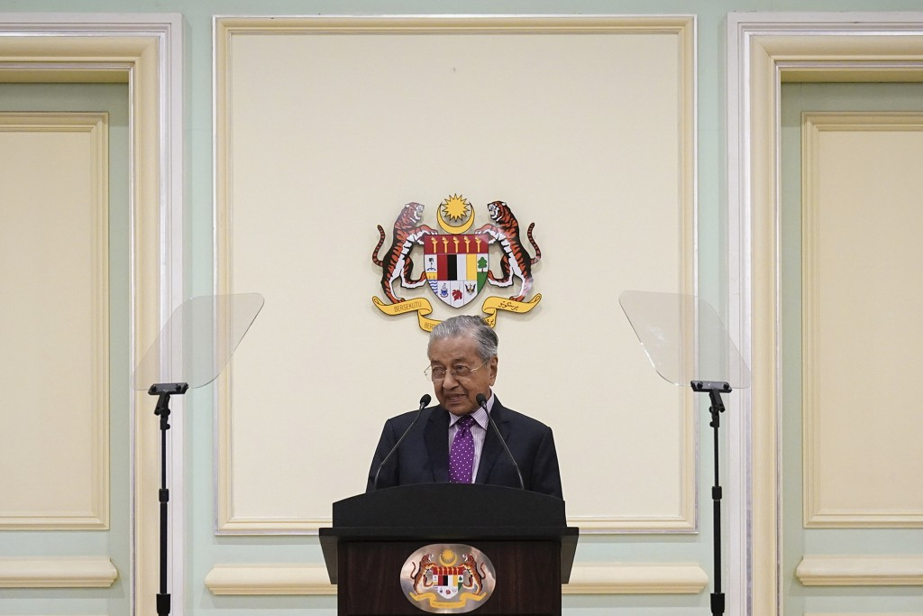 FILE - In this Feb. 27, 2020, file photo, Malaysian interim leader Mahathir Mohamad speaks during a press conference at his office in Putrajaya, Malay...