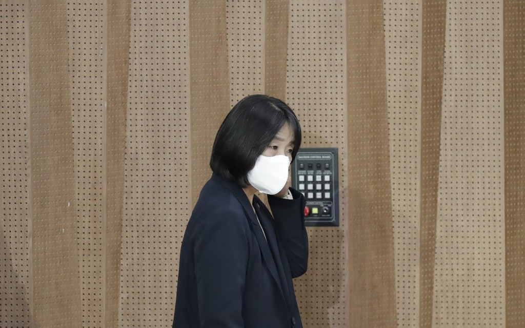 Activist Yoon Meehyang, who begins her four-year term as a lawmaker for the ruling liberal party on Saturday, wearing a face mask, arrives for a news ...