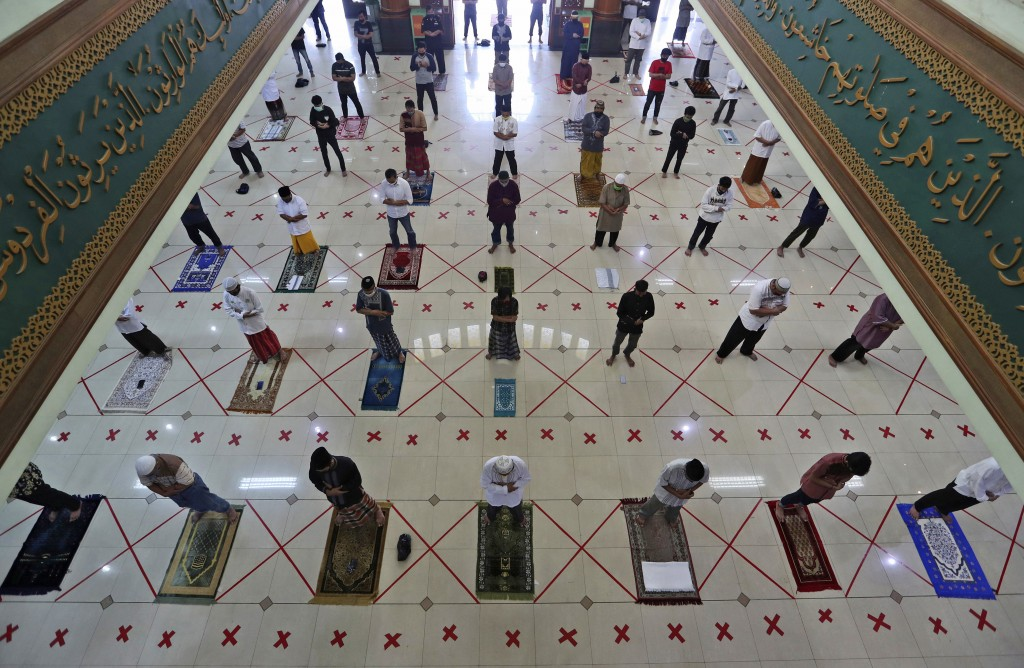 Muslims pray spaced apart to help curb the spread of the coronavirus during a Friday prayer at the Al Barkah Grand Mosque in Bekasi on the outskirts o...