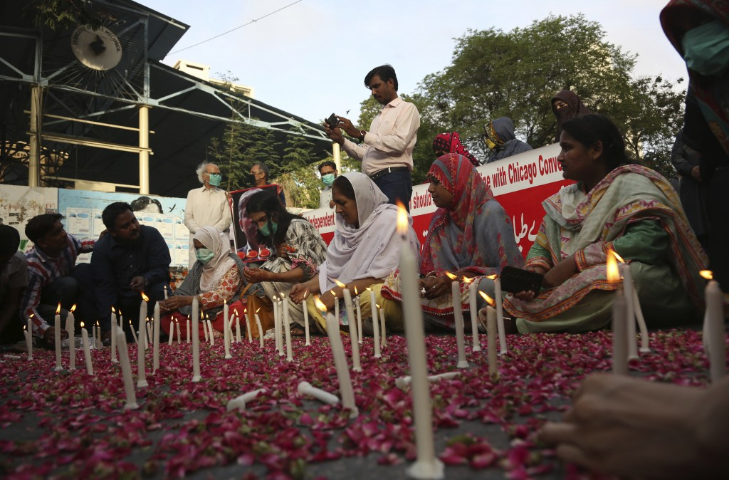 People attend candlelight vigil for victims of the crash of a state-run Pakistan International Airlines plane, in Karachi, Pakistan, Thursday , May 28...