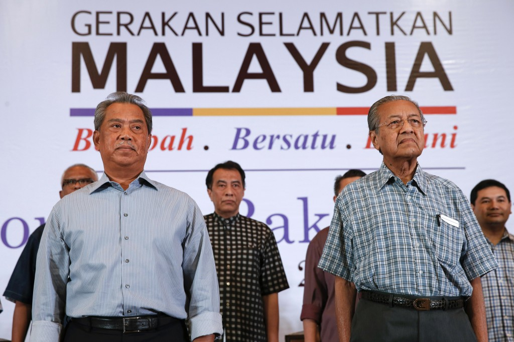 FILE - In this March 27, 2016, file photo, Malaysia's former Prime Minister Mahathir Mohamad, right, and former Deputy Prime Minster Muhyiddin Yassin ...
