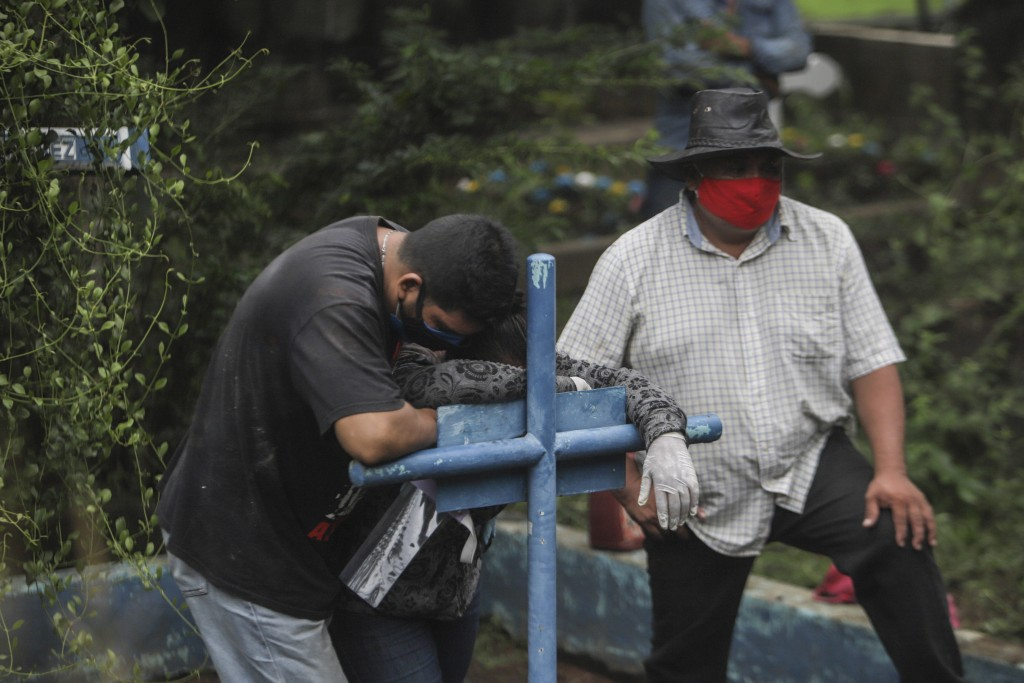 Relatives mourn at the funeral of Wilfredo Mendieta, 68, who died of symptoms related to COVID-19 in Monimbo Masaya cemetery, Nicaragua, Thursday, May...