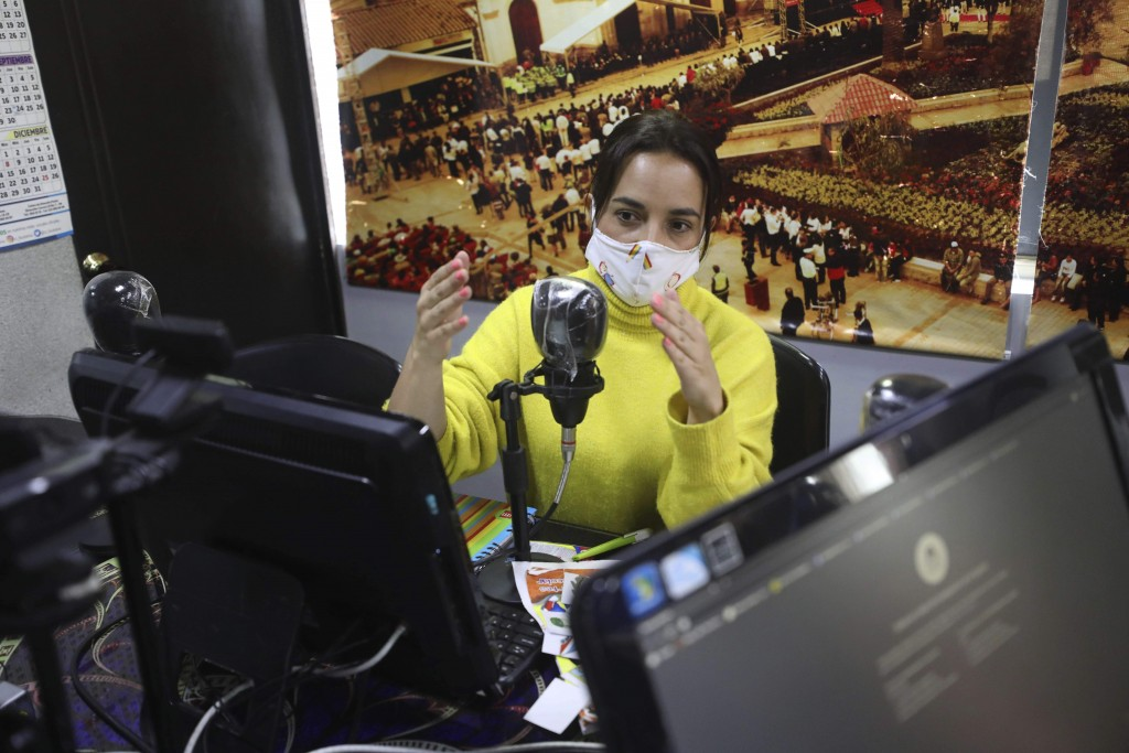 Diana Lopez imparts a one-hour class through Bacata Stereo radio station during the lockdown to prevent the spread of the new coronavirus in Funza, Co...