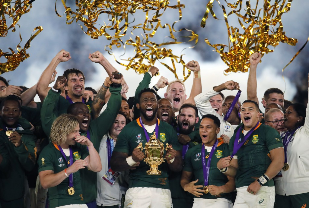 FILE  - In this Saturday, Nov. 2, 2019 file photo, South African captain Siya Kolisi holds the Webb Ellis Cup aloft after South Africa defeated Englan...