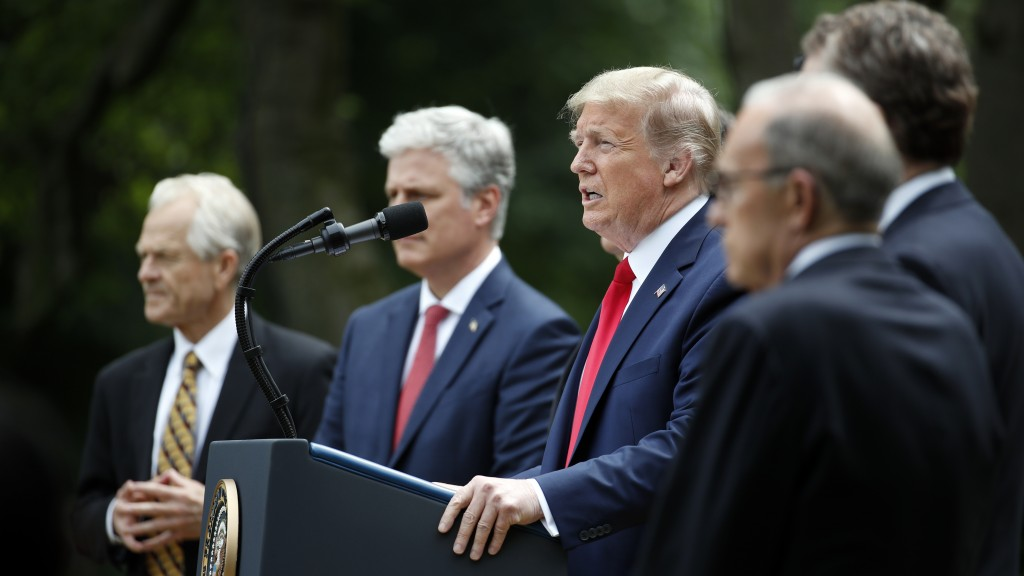 President Donald Trump speaks in the Rose Garden of the White House, Friday, May 29, 2020, in Washington, As White House trade adviser Peter Navarro, ...
