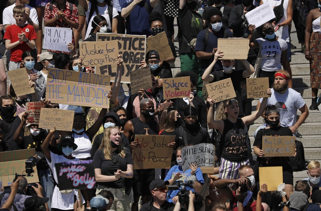 People gather in Trafalgar Square in central London on Sunday, May 31, 2020 to protest against the recent killing of George Floyd by police officers i...