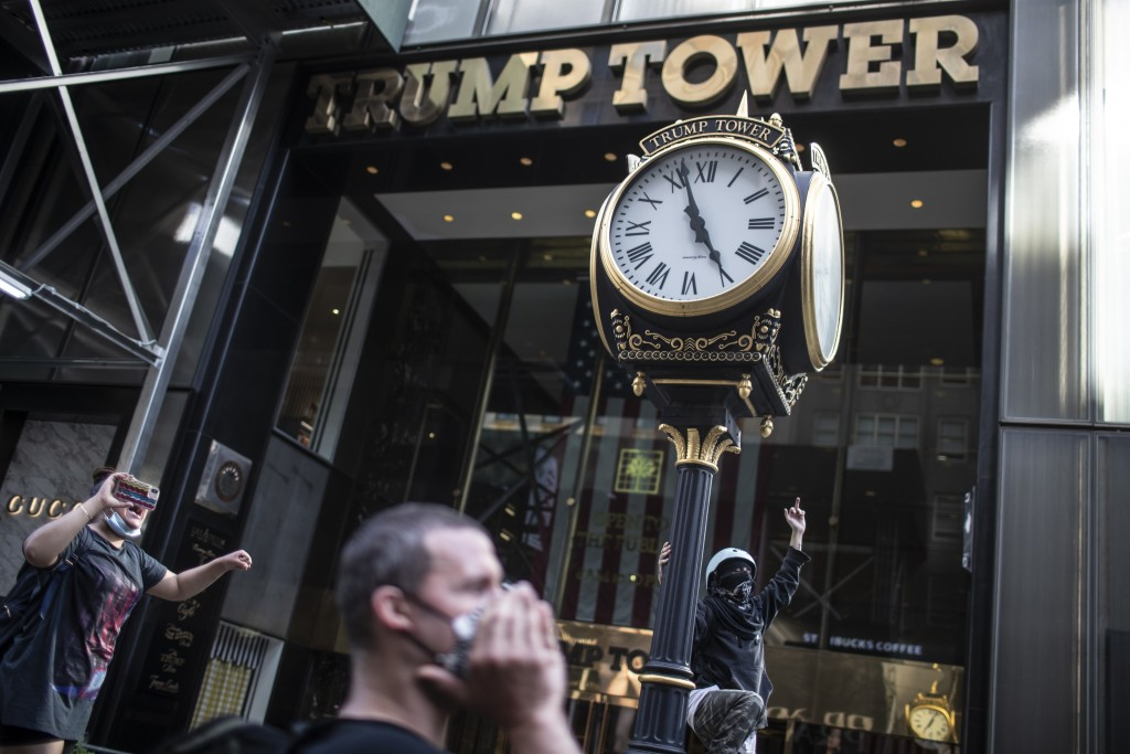 Protesters march in front of Trump Tower during a solidarity rally for George Floyd, Saturday, May 30, 2020, in New York. Demonstrators took to the st...