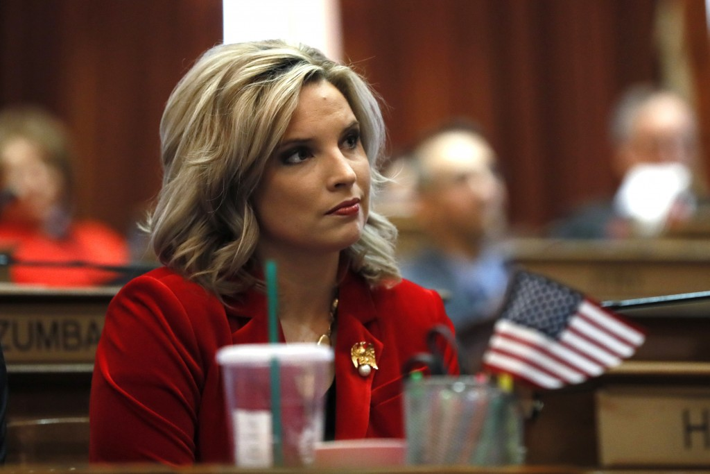 FILE - In this Jan. 13, 2020, file photo, State Rep. Ashley Hinson, R-Marion, watches as House Speaker Pat Grassley takes the oath of office during th...