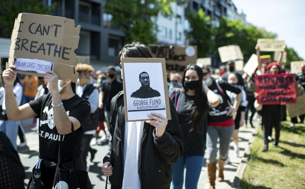People protest in Berlin, Germany, Sunday, May 31, 2020 after the violent death of the African-American George Floyd by a white policeman in the USA a...