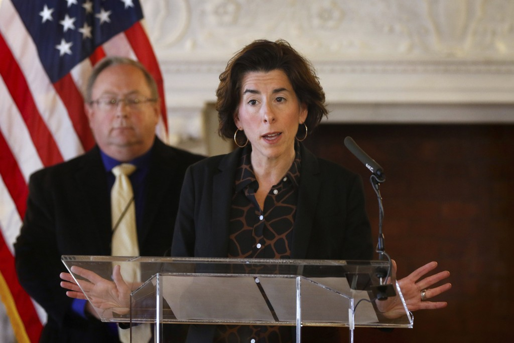 FILE - In this Sunday, March 22, 2020, file photo, Gov. Gina Raimondo gives an update on the coronavirus during a news conference, in Providence, R.I....