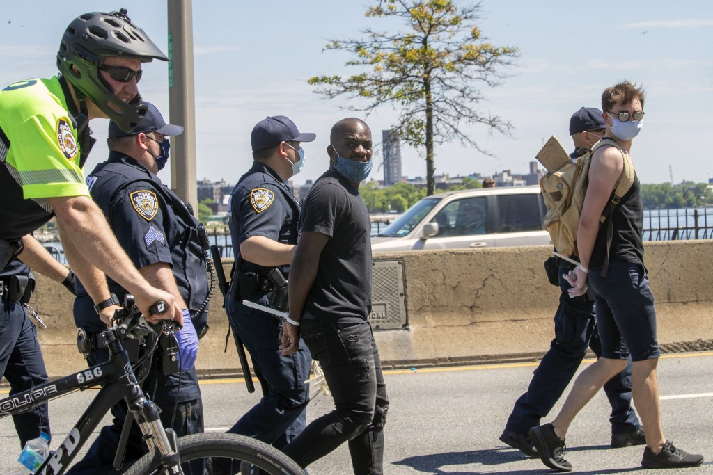 Protesters are arrested for blocking traffic on the FDR Drive while marching through Harlem during a solidarity rally for George Floyd, Saturday, May ...