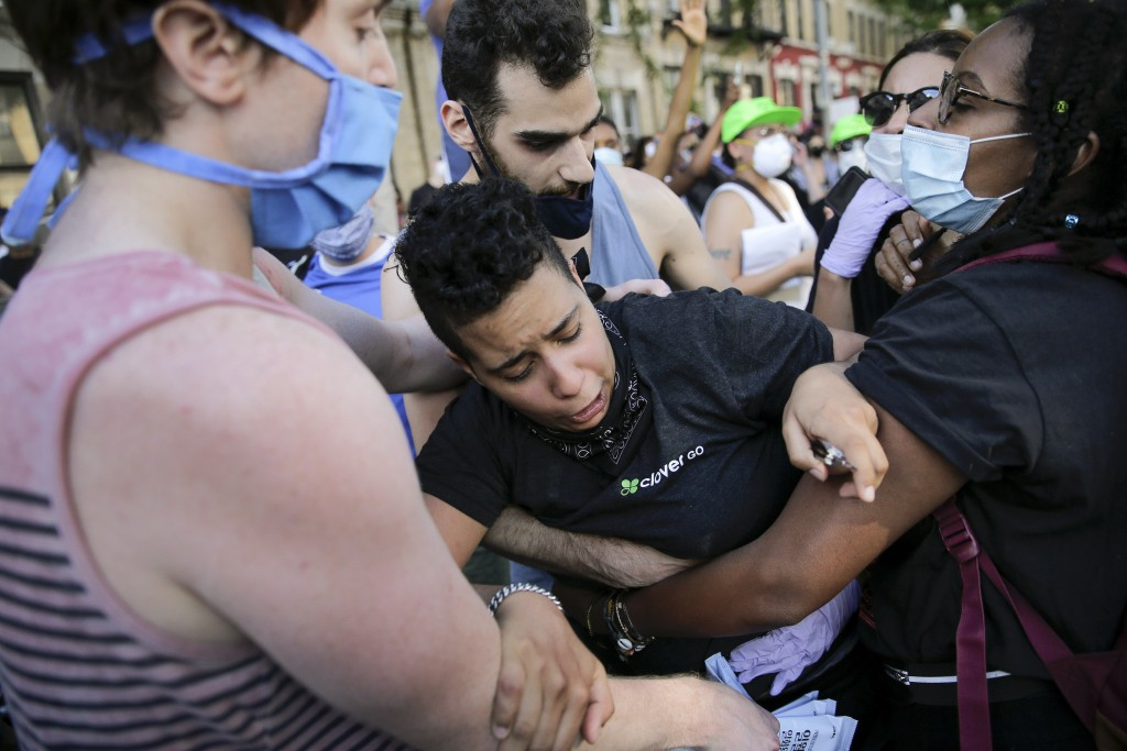 Protesters react during a demonstration Saturday, May 30, 2020, in the Brooklyn borough of New York. Protests were held throughout the city over the d...