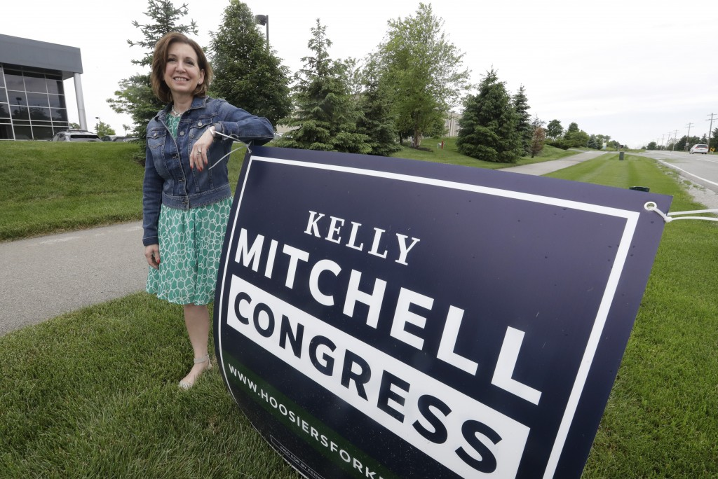 Indiana State Treasurer Kelly Mitchell stands by a campaign sign, Thursday, May 28, 2020, in Westfield, Ind. Mitchell is a candidate for Indiana's 5th...