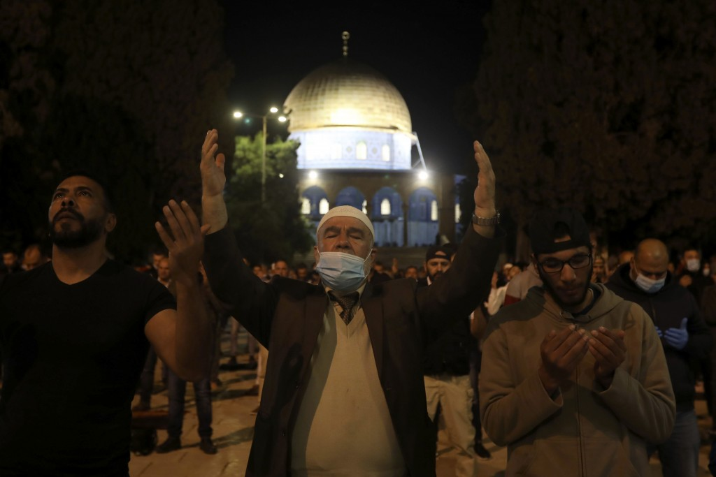 Muslim men pray next to the Dome of the Rock Mosque in the Al Aqsa Mosque compound in Jerusalem's old city, Sunday, May 31, 2020.The Al-Aqsa mosque in...
