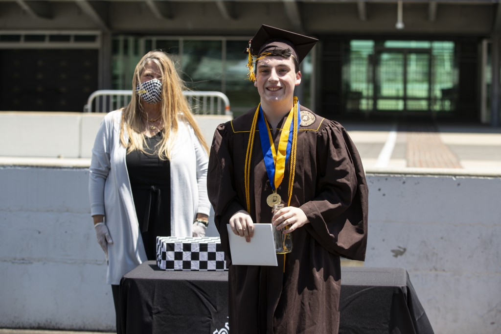 Jacob Foxworthy receives his Speedway High School diploma during a ceremony at the Indianapolis Motor Speedway in Indianapolis, Saturday, May 30, 2020...