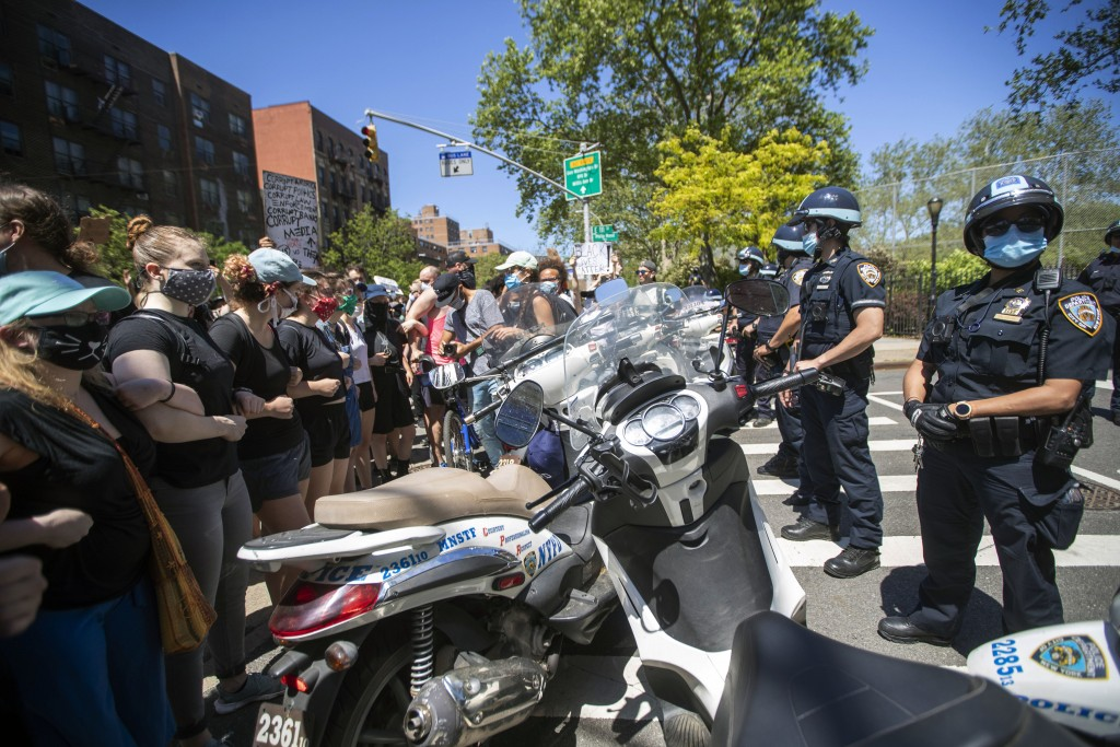 Protesters confront police blocking there access to the FDR Drive during a solidarity rally for George Floyd, Saturday, May 30, 2020, in New York. Flo...