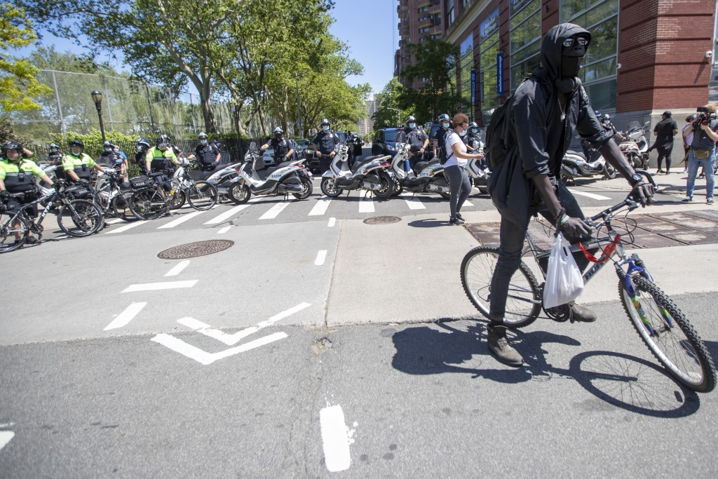 The police block 111th Street to keep protesters from reaching the FDR during a solidarity rally for George Floyd, Saturday, May 30, 2020, in New York...