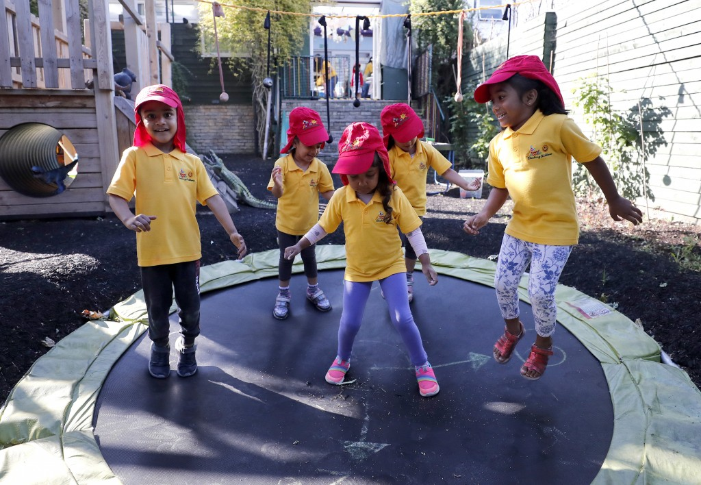 Children jump on a trampoline at the Little Darling home-based Childcare after nurseries and primary schools partly reopen in England after the COVID-...