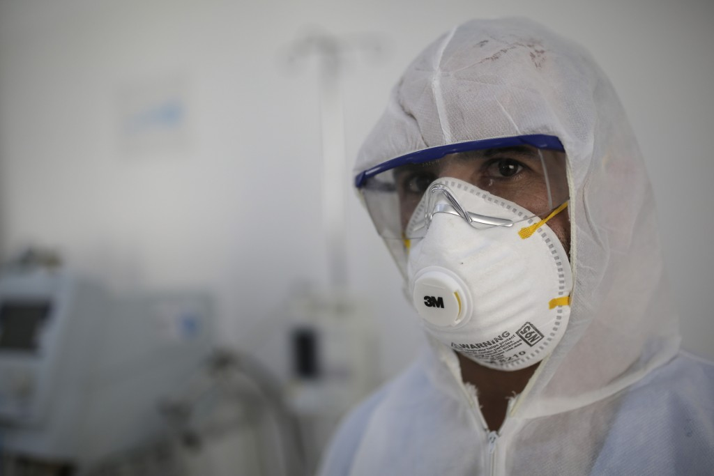 FILE - In this March 15, 2020 file photo, a medic sets up an isolation room in a coronavirus quarantine ward at a hospital in Sanaa, Yemen. Aid organi...