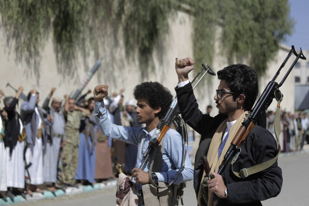 FILE - In this Feb. 25, 2020 file photo, tribesmen loyal to Houthi rebels chant slogans during a gathering aimed at mobilizing more fighters for the H...