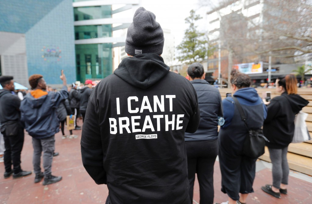 A demonstrator stands during a march in central Auckland, New Zealand, Monday, June 1, 2020, to protest the death of United States' George Floyd, a bl...