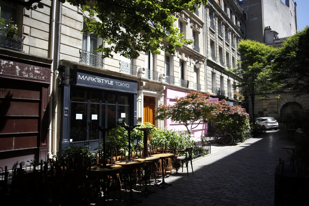 Chairs and tables of a cafe are stacked up in a street of the Marais district, in Paris, Monday, June 1, 2020. Parisians who have been cooped up for m...