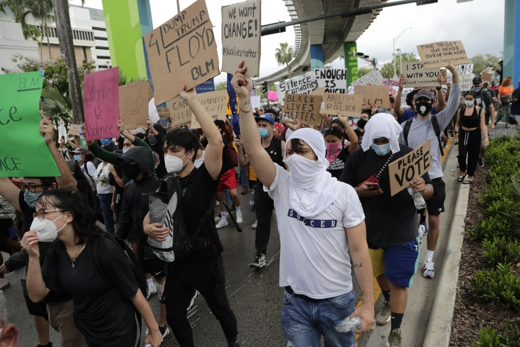 Protesters march through the streets over the death of George Floyd, Tuesday, June 2, 2020, in Miami. Protests were held throughout the country over t...