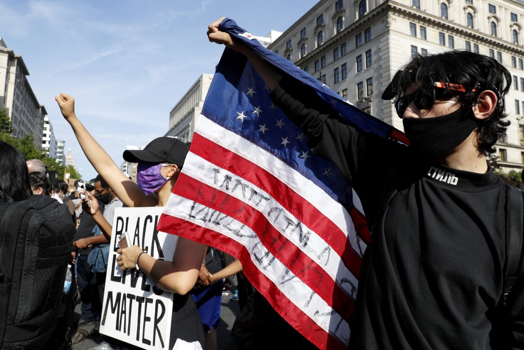 Demonstrators gather to protest the death of George Floyd, Tuesday, June 2, 2020, in Washington. Floyd died after being restrained by Minneapolis poli...