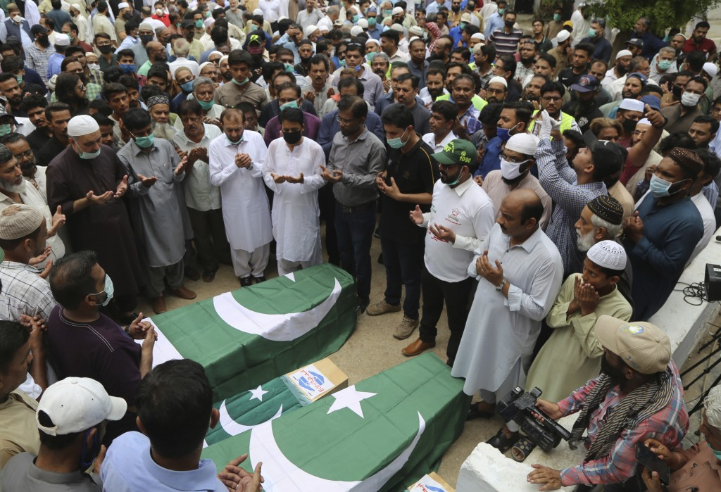 Mourners attend a funeral for some of the people who died in the crash of a state-run Pakistan International Airlines plane May 22, in Karachi, Pakist...
